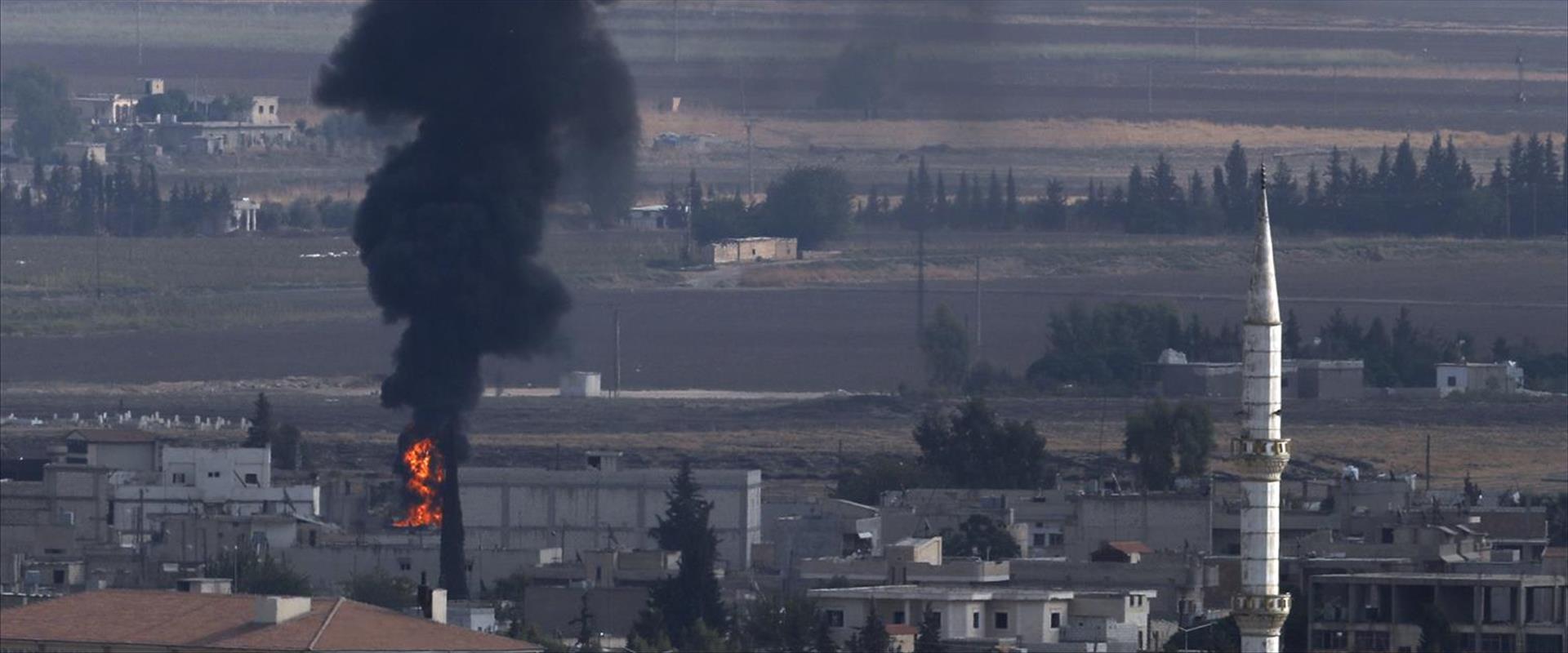 עשן בעיירה ראס אל עין בסוריה, אתמול