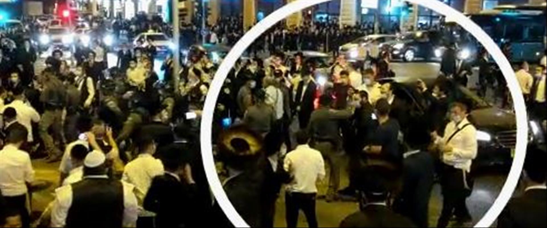 שוטר מכה מפגין חרדי בירושלים